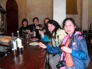 A group of Asian women are tasting sherry