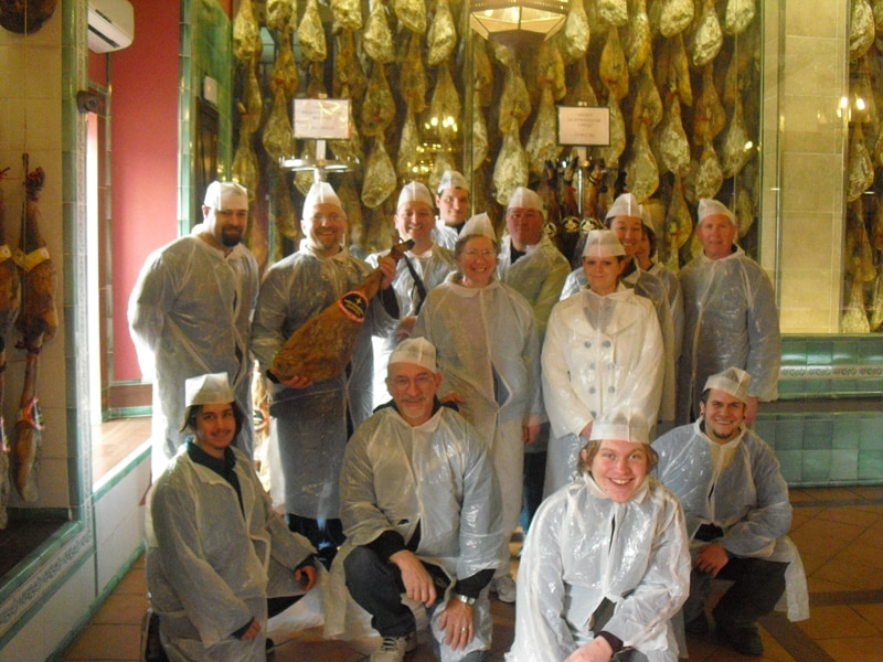 A culinary group on a visit to an Iberian ham curing factory