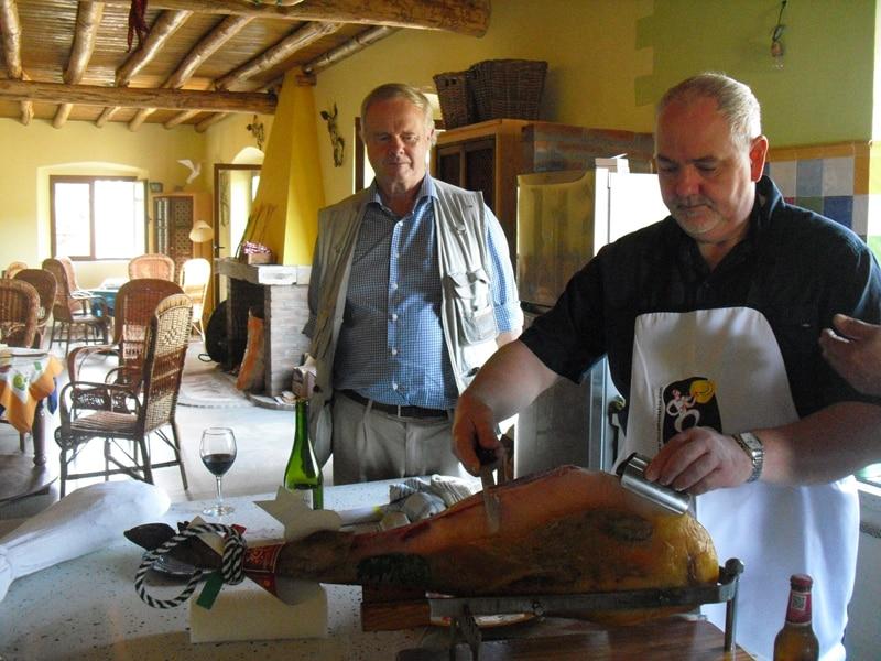 Cutting iberico ham on a farm