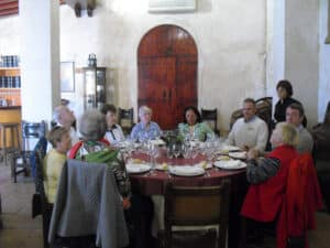 A group is sitting down for a meal at a sherry winery