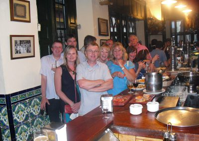 A group of people standing up during our tapas tours