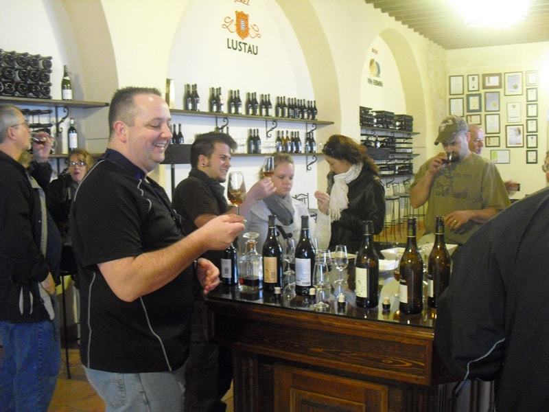 A group of people who are tasting sherry at a winery in the city of Jerez de la Frontera