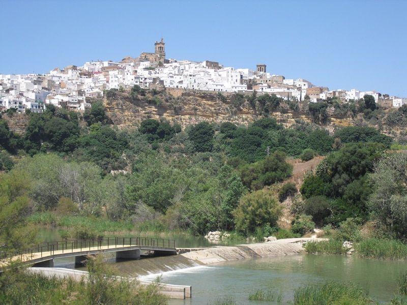 A view of the white town Arcos de la Frontera from the river Guadalete