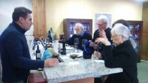 A group of people tasting wine at a winery