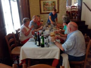 A group tasting wine around a table in an old restaurant in Seville