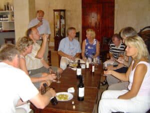 A group sitting around a table tasting sherry