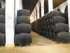 Stacks of sherry casks in side a winery building in Jerez