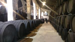A large winery building with sherry butts
